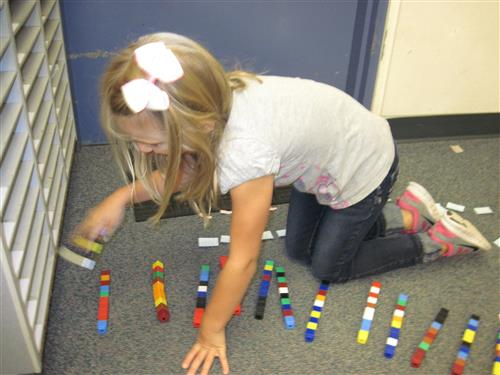 Student counting with math manipulatives