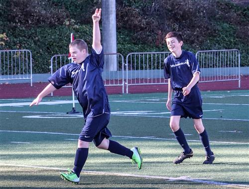 Wilsonville High School Unified Soccer players celebrate a goal.