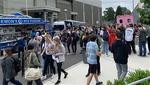 Students enjoy food trucks on Unity Day May 24.