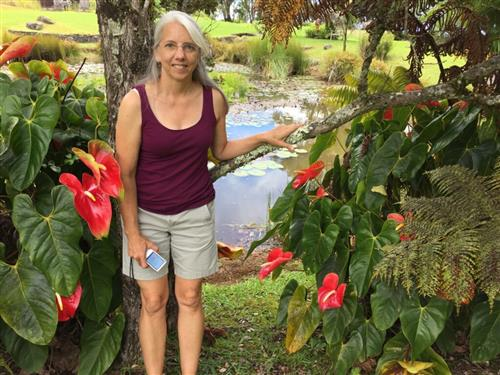 Ms. Sutter enjoying a beautiful pond with water lillies and other plants in Hawaii 2017.