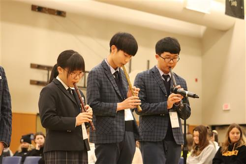 South Korean students perform for Athey Creek students on January 16.