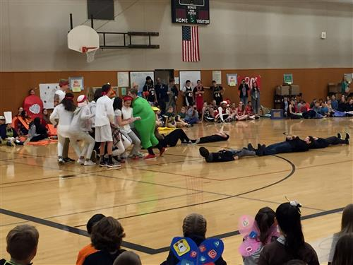 Athey Creek Middle School students act out a lifesize bowling scene on Friday, Nov. 17.