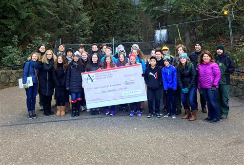 Athey Creek eighth-graders donated $9,000 to Eagle Creek restoration efforts on Wednesday, Dec. 13.